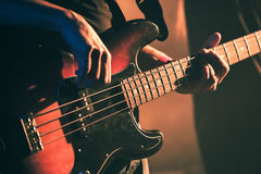 Vintage toned bass guitar player Stock Photo