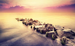 Vintage toned beautiful sea landscape after sunset. Stock Photography