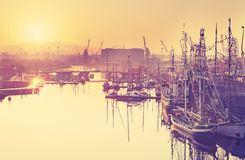 Vintage toned beautiful sunrise over harbor. Royalty Free Stock Photos