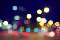 Vintage toned blurred street lights at night. Royalty Free Stock Photography