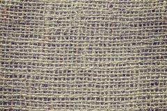 Vintage toned close up picture of natural jute fabric Stock Photo