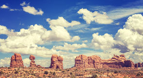 Vintage toned cloudscape over rock formations in Arches National Royalty Free Stock Image