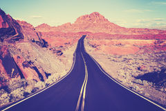 Vintage toned curved desert highway, travel concept, USA Stock Image
