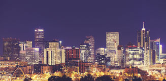 Vintage toned Denver downtown skyline at night, USA. Royalty Free Stock Photos