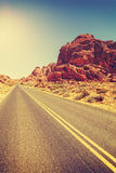 Vintage toned desert highway, travel concept, USA Royalty Free Stock Photography