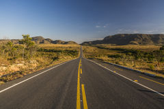 Vintage toned desert long road just before sunrise, travel concept, Brazil Stock Image