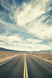 Vintage toned desert road in Death Valley. Stock Image