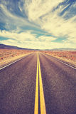 Vintage toned desert road, Death Valley, USA. Stock Photo
