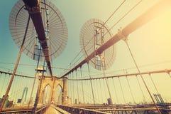 Vintage toned fisheye lens picture of Brooklyn Bridge. Stock Image