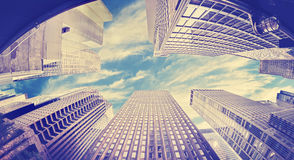Vintage toned fisheye photo of skyscrapers in NYC, USA Stock Images