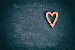 Vintage toned heart on grunge stone background. Royalty Free Stock Photography
