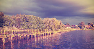 Vintage toned long wooden pier at sunset Royalty Free Stock Photography