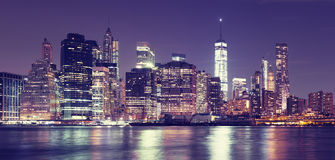 Vintage toned New York City at night panoramic picture. Stock Photo