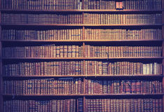 Vintage toned old books on wooden shelves. Stock Photography