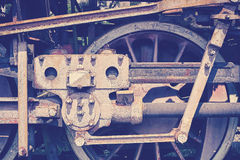 Vintage toned old rusty steam locomotive wheel Stock Image