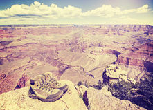 Vintage toned old trekking shoes in Grand Canyon, USA. Royalty Free Stock Photography