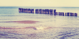 Vintage toned panoramic beach view with tilt shift effect. Stock Photos