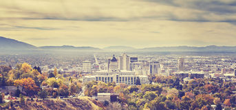 Vintage toned panoramic picture of Salt Lake City skyline. Stock Images