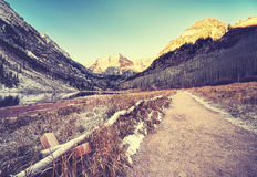 Vintage toned path to Maroon Bells at sunrise, Colorado, USA.  Royalty Free Stock Photos