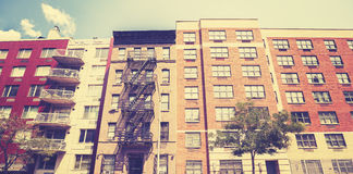 Vintage toned photo of New York building with fire escape ladder Stock Photography