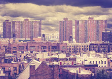 Vintage toned photo of New York residential buildings, Harlem. Stock Photos