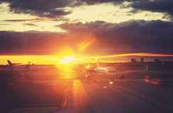 Vintage toned picture of airport at sunset, travel concept. Royalty Free Stock Photography