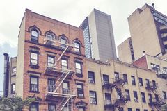 Vintage toned picture of buildings in New York. Vintage toned picture of buildings with fire escapes in the New York City, USA Stock Photography