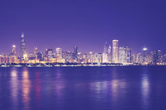 Vintage toned picture of Chicago city skyline at night. Stock Photos