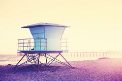 Vintage toned picture of a lifeguard tower at sunset. Stock Images