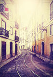 Vintage toned picture of street in Lisbon. Royalty Free Stock Photos