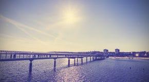 Vintage toned pier against sun. royalty free stock photos