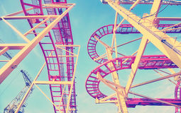 Vintage toned rollercoaster track construction in amusement park Royalty Free Stock Photography