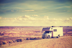 Vintage toned RV (camper) parked by canyon. Royalty Free Stock Image
