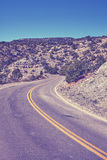 Vintage toned scenic curved road, travel concept background, Col Royalty Free Stock Photo