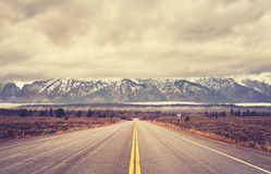 Vintage toned scenic road in the Grand Teton National Park, USA. Vintage toned scenic road in the Grand Teton National Park, Wyoming, USA Royalty Free Stock Photos