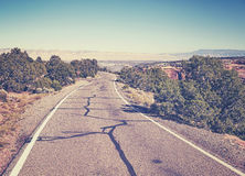 Vintage toned scenic road, travel concept background, USA. Royalty Free Stock Image