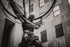 Vintage toned  statue of Atlas in New York City`s Fifth Avenue. Vintage toned statue of Atlas holding the celestial spheres in New York City`s Fifth Avenue Stock Image