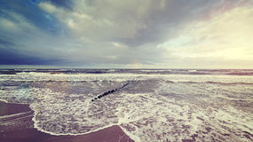 Vintage toned stormy sky over rough sea. Royalty Free Stock Photos