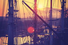 Vintage toned sunrise over harbor. Royalty Free Stock Images