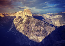 Vintage toned sunset above Half Dome rock. Stock Images