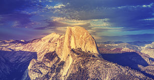 Vintage toned sunset above Half Dome rock in Yosemite. royalty free stock image