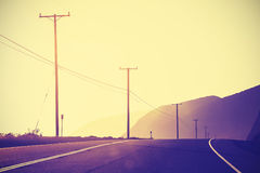 Vintage toned sunset at Pacific Highway, California, USA.  royalty free stock images