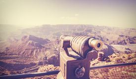 Vintage toned telescope at Grand Canyon, travel concept. Royalty Free Stock Photo