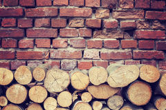 Vintage toned tree stumps and old brick wall background Stock Photos