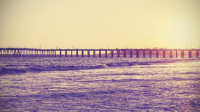 Vintage toned wooden bridge at sunset, California, USA Stock Photo