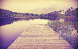 Vintage toned wooden lake pier Royalty Free Stock Image