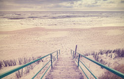 Vintage toned wooden stairs on a beach Royalty Free Stock Images