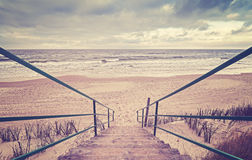 Vintage toned wooden stairs on a beach Stock Photos