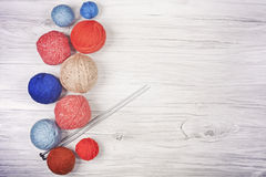 Vintage toned yarn balls on wooden boards. Stock Photos