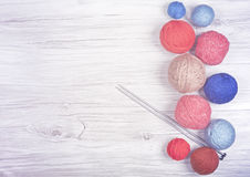 Vintage toned yarn balls on wooden boards. Stock Photo